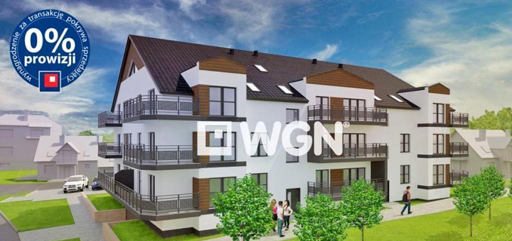 zdjęcie przedstawia apartamentowiec z zewnątrz, w którym znajduje się oferowany apartament na sprzedaż