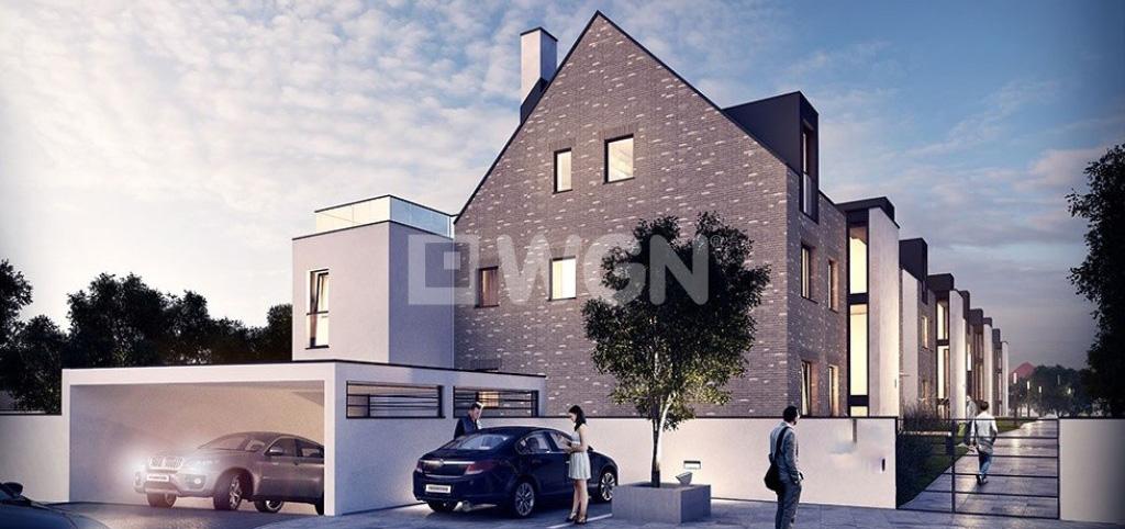 zdjęcie przedstawia apartamentowiec w którym położony jest oferowany apartament