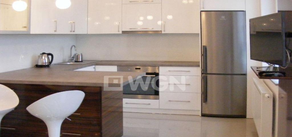 na zdjęciu widok na aneks kuchenny w apartamencie do wynajęcia w Katowicach