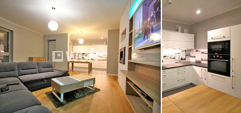 na zdjęciu saloon oraz fragment kuchni w apartamencie w Szczecinie do sprzedaży