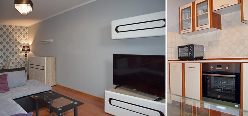 zdjęcie przedstawia salon oraz fragment kuchni w apartamencie do wynajmu w Słupsku