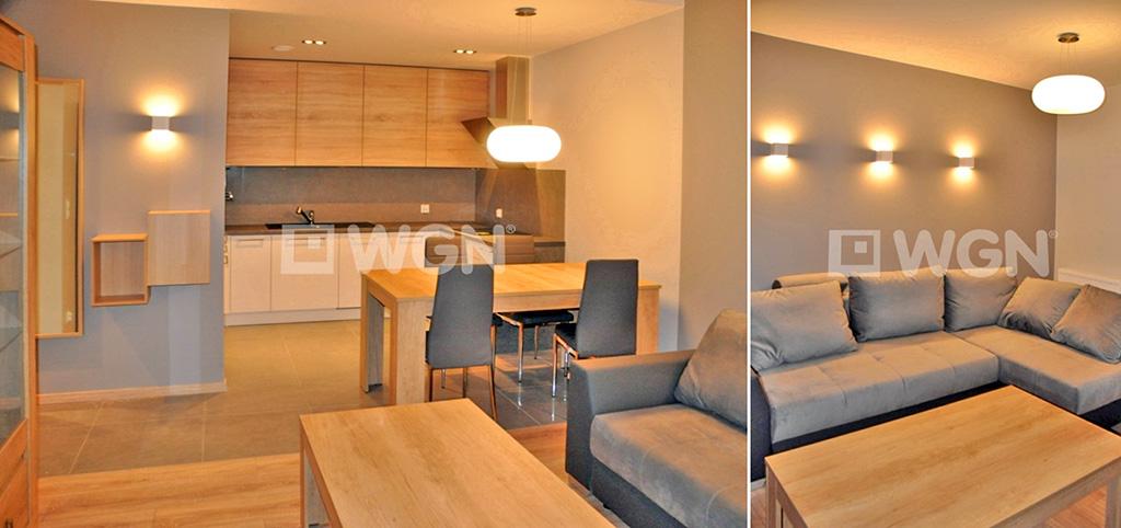 zdjęcie prezentuje widok z salonu na aneks kuchenny w apartamencie do wynajęcia w Szczecinie