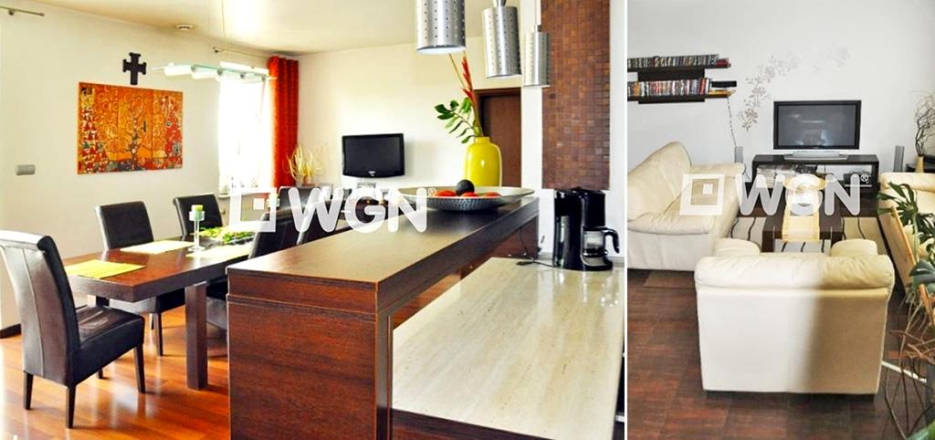 zdjęcie przedstawia widok z aneksu kuchennego na salon w luksusowym apartamencie na sprzedaż w Katowicach