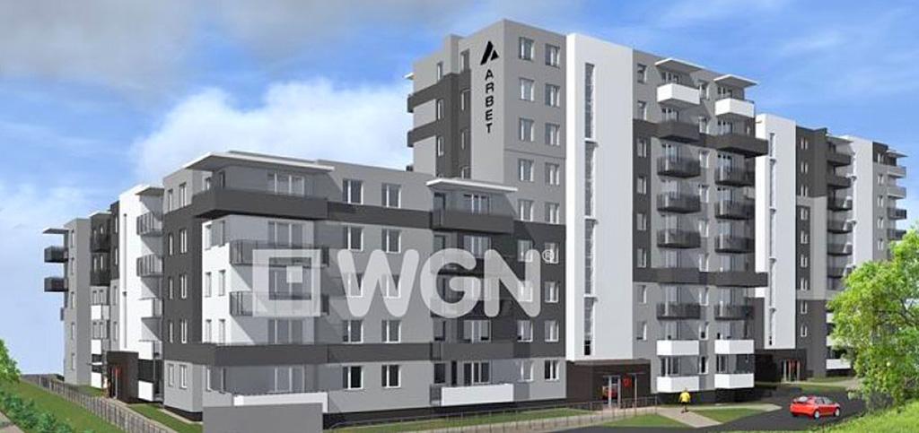 widok na apartamentowiec w Olsztynie, w którym znajduje się oferowany ana sprzedaż apartament