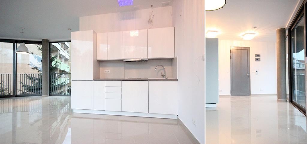 na zdjęciu luksusowy aneks kuchenny oraz fragment salonu w apartamencie do wynajęcia w Szczecinie