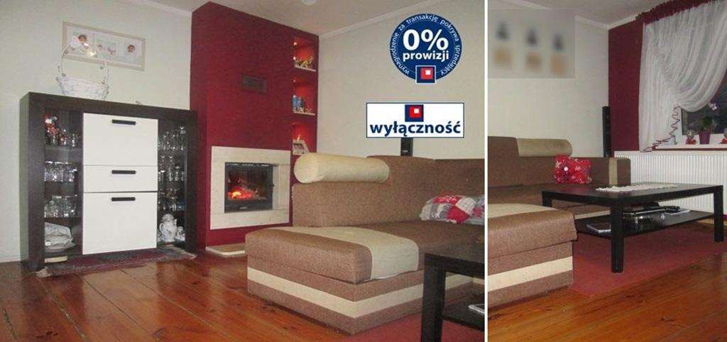 na zdjęciu salon z kominkiem w ekskluzywnym apartamencie do sprzedaży w okolicach Żagania