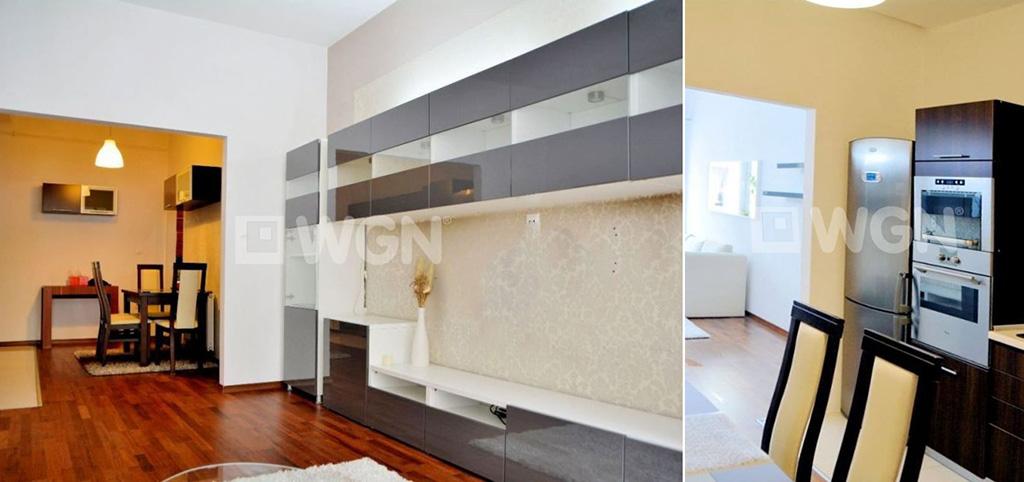 na zdjęciu komfortowo urządzony aneks kuchenny wraz z fragmentem salonuw apartamencie do sprzedaży w okolicach Warszawy