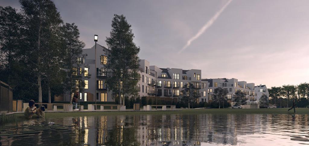 zdjęcie prezentuje widok od strony rzeki na kompleks luksusowych apartamentowców we Wrocławiu, gdzie znajduje się ekskluzywny apartament na sprzedaż