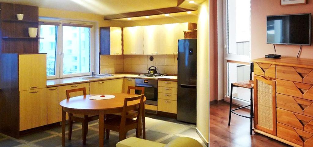 na zdjęciu aneks kuchenny oraz fragment salonu w apartamencie do sprzedaży w Białymstoku