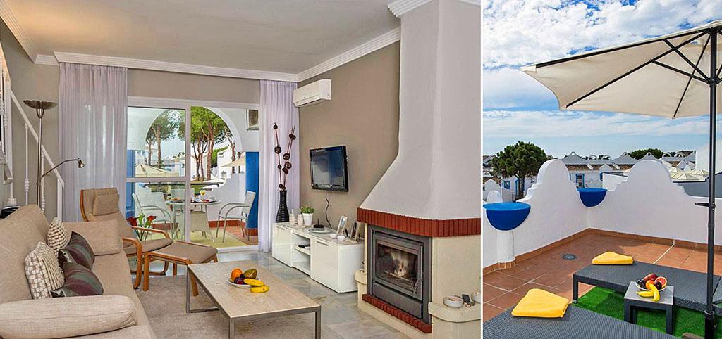 na zdjęciu luksusowy salon z kominkiem oraz fragment tarasu w luksusowym apartamencie do sprzedaży w Hiszpanii