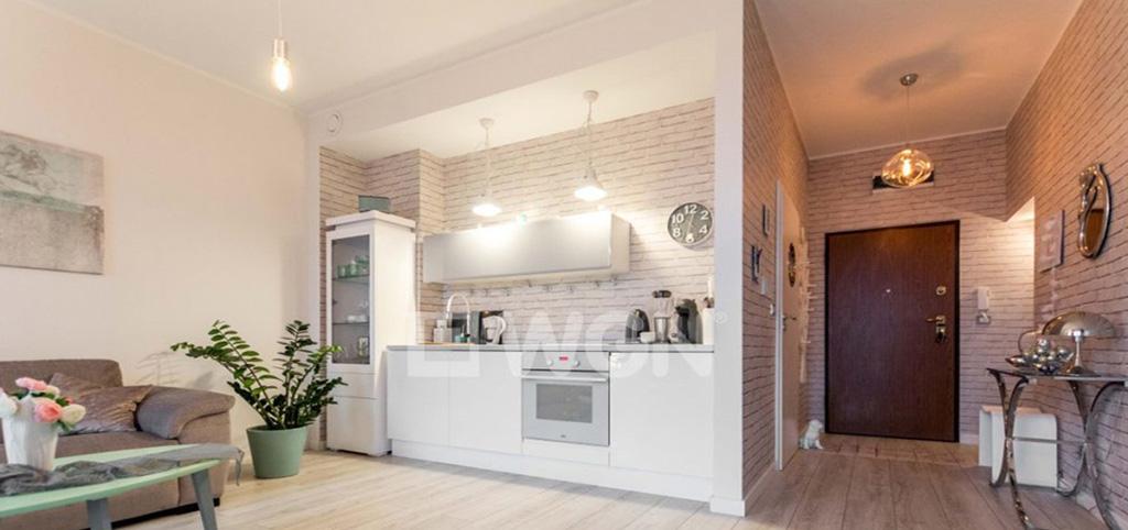 na zdjęciu ekskluzywnie wyposażony aneks kuchenny w apartamencie do sprzedaży w Szczecinie