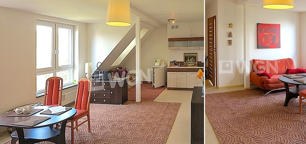 widok na salon oraz aneks kuchenny w apartamencie do wynajęcia w Szczecinie